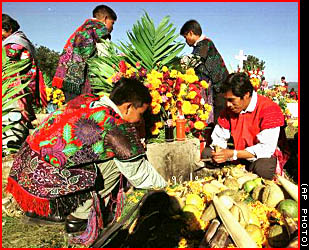 flowers and food for the day of the dead at the zinacantan cemetery in mexico